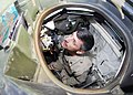 US Navy 070416-N-2903M-005 Commander, Carrier Strike Group Two Rear Adm. Mike C. Vitale peers through the commander's hatch of a U.S. Marine Corps M1A1 Abrams main battle tank.jpg