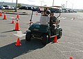 US Navy 070522-N-6247M-007 Master at Arms 3rd Class David Barnett, from Belgrade, Mt. (Driver), and Master at Arms 1st Class Daniel Bellwood, from Methuen, Mass. (Passenger), drive a golf cart through traffic cones while wearin.jpg
