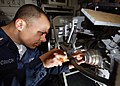 US Navy 070714-N-7981E-014 Fire Controlman 3rd Class Anthony Picinich, assigned to Combat Systems Department, performs repairs on the gimbal motor of a phase array search antenna for the ship's close in weapons system.jpg