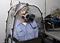 US Navy 071205-N-6566M-070 Information Systems Technician 3rd Class Stephen A. Hoover, assigned the command ship USS Blue Ridge (LCC 19), tests to guarantee a proper fitting chemical biological and radiological (CBR) mask siz.jpg