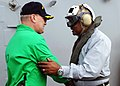 US Navy 080728-N-9116H-003 Capt. Ladd Wheeler, commanding officer of the aircraft carrier USS Theodore Roosevelt, left, welcomes aboard Assistant Secretary of the Navy B.J. Penn.jpg