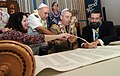 US Navy 081026-N-9758L-097 Torah dedication ceremony participants write one of the last letters in a new Sefer Torah at the Aloha Jewish Chapel at Naval Station Pearl Harbor.jpg