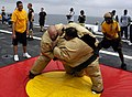 US Navy 090214-N-3316L-109 Storekeeper 2nd Class Dale Newman and Hospital Corpsman 1st Class Karl Kho compete in a sumo wrestling contest during a steel beach picnic.jpg
