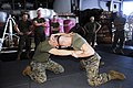 US Navy 090521-N-0096C-004 Sgt. Erick Lent, left, from Tampa, Fla., and Sgt. Scott Bryant, from Morristown, Tenn., practice a clinch move grappling maneuver during a Marine Corps Martial Arts Program training session.jpg