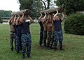 US Navy 090814-N-0634R-126 Sailors from Tactical Air Control Squadron (TACRON) 21 carry logs during conditioning training.jpg