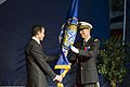 US Navy 090909-F-9208L-187 French Air Force Gen. Stéphane Abrial receives the Allied Command Transformation flag from NATO Secretary General Anders Fogh Rasmussen.jpg