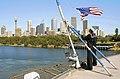 US Navy 090929-N-1083F-039 U.S. Sailors raise the national ensign as the amphibious command ship USS Blue Ridge (LCC 19) arrives pierside in Sydney Australia.jpg