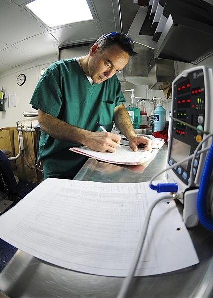 File:US Navy 100129-N-9950J-091 A dental officer updates records aboard USS Essex.jpg