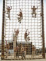 US Navy 100708-N-0775Y-015 Sailors assigned to Fleet Combat Camera Group Pacific, navigate the rope climb portion of the obstacle course at the Naval Special Warfare Center in Coronado, Calif.jpg