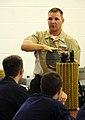 US Navy 100803-N-7498L-019 Hull Technician 1st Class David DeVoe, an instructor assigned to the Center for Naval Engineering Learning Site, Pearl Harbor, demonstrates the use of a portable electric submersible pump.jpg