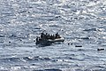 US Navy 100927-N-3304W-005 A rigid-hull inflatable boat from the guided-missile destroyer USS Winston S. Churchill (DDG 81) rescues passengers of a.jpg