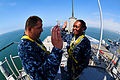 US Navy 110520-N-KD852-017 Lt. Cmdr. Antonio Ochoa reenlists Electronics Technician 2nd Class Justine Pennel for six more years from the top of the.jpg