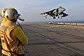 US Navy 110622-N-ZZ999-020 Aviation Boatswain's Mate 2nd Class (Handling) Manuel Arias watches as an AV-8B Harrier from Marine Attack Squadron (VM.jpg