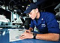 US Navy 110825-N-XR557-106 Quartermaster 3rd Class Kendall O'Connor plots a fix verifying the ship's position aboard the guided-missile destroyer U.jpg