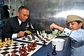 US Navy 111003-N-BS854-252 Chief Logistics Specialist Dante Castillo participates in a chess tournament with Russian children aboard the guided-mis.jpg