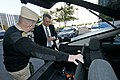 US Navy 111020-N-PM781-008 Tom Hicks, right, Deputy Assistant Secretary of the Navy for Energy, looks at the battery compartment of a Chevrolet Vol.jpg