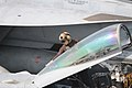 US Navy 120111-N-GZ832-336 A plane captain cleans the canopy of an F-A 18C Hornet on the flight deck aboard the Nimitz-class aircraft carrier USS C.jpg