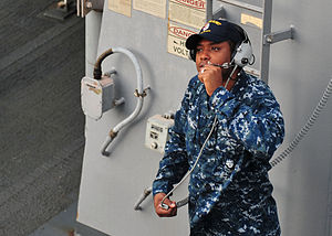 US Navy 120130-N-ED900-014 A Sailor communicates with the bridge prior to leaving Singapore.jpg