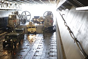 US Navy 120131-M-DK975-012 Marines assigned to Combat Cargo unload humvees from a U.S. Navy landing craft, air cushion (LCAC) during exercise Bold.jpg