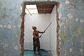 US Navy 120201-A-IP644-082 A Sailor re-paints a wall during a service project in Zona De Acapulco.jpg