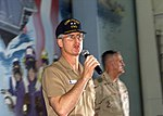 US Navy Rear Adm. James McArthur addresses the Sailors and Marines of USS Harry S. Truman (CVN 75) during a visit by US Army Gen. Henry Shelton (background) in the ship's hangar bay.jpg