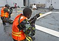 Ugandan service members guard simulated detainees aboard a vessel during exercise Cutlass Express 2013 in the Gulf of Tadjoura off the coast of Djibouti Nov. 14, 2013 131114-F-NJ596-116.jpg