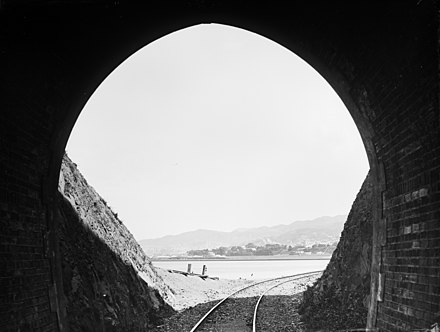 Thorndon 1880s from a Kaiwarra tunnel View of Thorndon, Wellington, from inside a railway tunnel in Kaiwharawhara, 1880s (3057507064).jpg