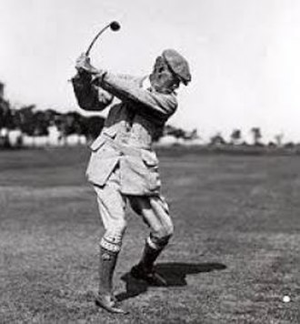 Walter Travis - Travis at the beginning of the downswing (c. 1919). Note the flexing of the hickory shafts used during the period.