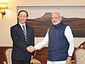 Wang Jiarui, Minister, International Department of the Central Committee of the Communist Party of China, with PM Narendra Modi.jpg