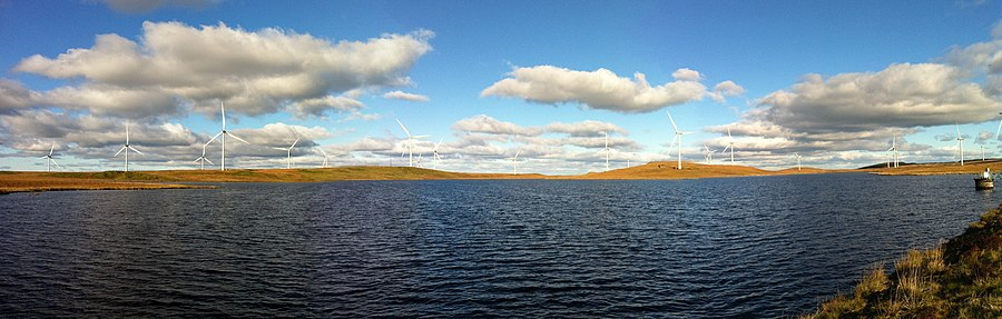 A panoramic view of the United Kingdom's Whitelee Wind Farm with Lochgoin Reservoir in the foreground. Whitelee panorama.JPG