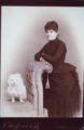 Woman and dog by F Haffner and Co of Cumberland Maryland USA.png