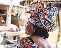 Woman of the Gambia with a colored head scarf.jpg
