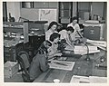 Women USGS geologists working with maps during WWII.jpg