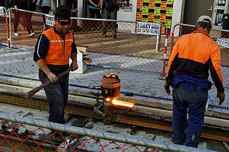 Tramway track - Image: Workers join tram tracks in Christchurch