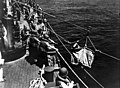 Wounded seaman transferred to ship during Battle of Midway 1942.jpg