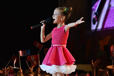 Daneliya Tuleshova represented Kazakhstan at the Junior Eurovision Song Contest 2018. Данэлия Тулешова (день 1) на Детской Новой волне 2015.jpg