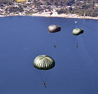 Lake Ilopango - U.S. Soldiers with the 7th Special Forces Group and Salvadoran service members maneuver after jumping from the ramp of a U.S. Army CH-47 Chinook helicopter during a joint airborne operations training exercise over Lake Ilopango, El Salvador, Jan. 21, 2014. The training allowed service members from both nations to maintain currency while strengthening the relationship between the forces. (DoD photo by Capt. Zach Anderson, U.S. Air Force/Released)