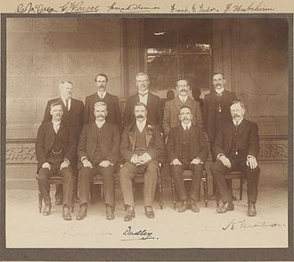 First Fisher Ministry - The First Fisher Ministry; from left to right:   Standing: McGregor, Pearce, Thomas, Tudor, Hutchison   Seated: Batchelor, Fisher, Lord Dudley (Governor-General), Hughes, Mahon