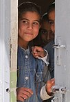 2-320th FAR & ISF give to Iraqi school children DVIDS90856.jpg