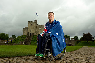 Australia at the 2012 Summer Paralympics - Greg Smith wraps himself in the Australian Flag outside Cardiff Castle after the announcement that he would be the 2012 Australian Flag Bearer