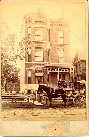 Lincoln Park, Chicago - This is an 1880s photo of 653 W. Wrightwood (now 655 W. Wrightwood) in the Lincoln Park neighborhood, the building is typical of the victorian-era structures in the area. Note the wooden sidewalk, dirt road and lack of buildings surrounding the edifice.