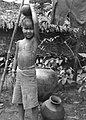 A Burmese Boy Carrying Water (BOND 0549).jpg