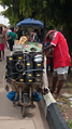 A Nigerian man selling kerosene stoves and stove parts.png