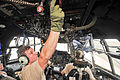A U.S. Airman, left, with the 303rd Expeditionary Rescue Squadron (ERQS) performs pre-flight procedures inside an HC-130 P-N Combat King aircraft before takeoff from Camp Lemonnier in Djibouti March 28, 2014 140328-F-CU844-051.jpg