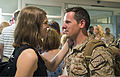 A U.S. Sailor, right foreground, with Explosive Ordnance Disposal Group 2 is greeted by his family upon returning to Norfolk, Va., June 1, 2013, after a 12-month deployment to Afghanistan in support of Combined 130601-N-AP176-097.jpg