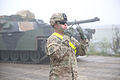 A U.S. Soldier with the 2nd Battalion, 12th Cavalry Regiment ground guides an M1A2 Abrams tank in Parsberg, Germany, Oct. 18, 2014, during Combined Resolve III 141018-A-DI345-014.jpg