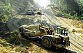 A West Virginia Army National Guard earthmoving scraper works on a roadcut.JPEG