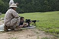 A business leader attending a Marine Corps Executive Forum (MCEF) fires an M27 rifle at a target under the supervision of a U.S. Marine aboard Marine Corps Base Quantico, Va., July 11, 2013 130711-M-MI461-296.jpg