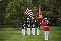 A member from the U.S. Marine Band plays taps (17455429388).jpg