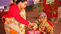 A para-medical staff administering pulse polio dose to a child at Bharat Nirman Navoday Utsav camp at Baneswar, West Bengal on December 21, 2008.jpg